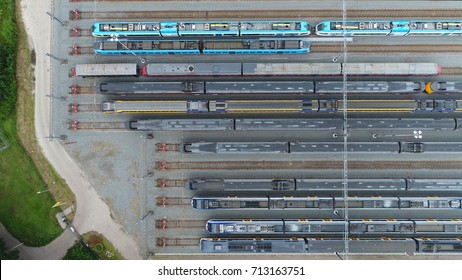 Aerial photo of railway hub showing passenger trains on tracks next to each other top down view railway tracks positioned horizontally above each other