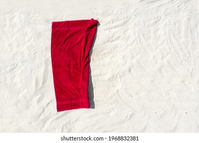 Aerial photo of red towel on beach and free space for your decoration. Summer time.
