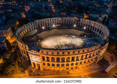Aerial photo of Roman Colosseum in Pula, Croatia at night