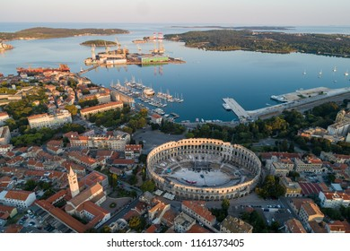 Aerial photo of Roman Colosseum in Pula, Croatia at sunrise