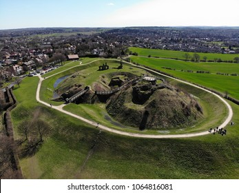 Aerial photo of the ruins of Sandal Castle in Wakefield, West Yorkshire in the UK, this old Castle is near a small town and it also near to farmers field of each side, around the ruins is also a moat