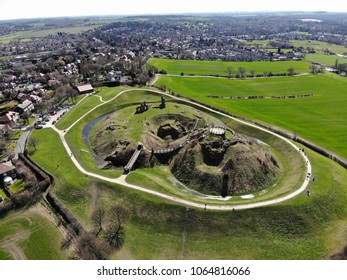 Aerial photo of the ruins of Sandel Castle in Wakefield, West Yorkshire in the UK, this old Castle is near a small town and it also near to farmers field of each side, around the ruins is also a moat.