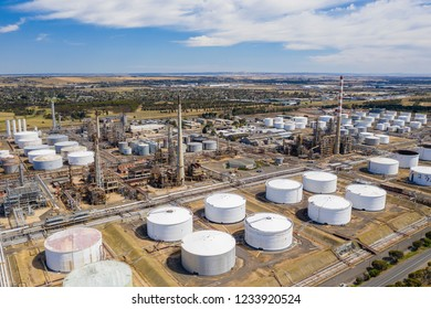 Aerial photo of storage tanks and production facilities of an oil refinery