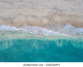 Aerial photo of surf at tropical beach