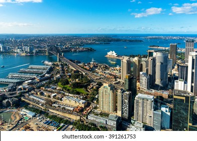 Aerial photo of Sydney CBD with skyline and Harbour bridge. Sydney iconic Harbour Bridge and CBD office buildings. Bird's eye view from above on Sydney CBD and Sydney Harbour