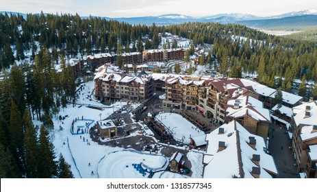 Aerial photo taken with drone of Northstar Resort, Lake Tahoe CA, USA, West Coast, wintertime after a heavy snow, with the lake in the background