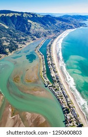 Aerial photo taken over Stinson Beach, CA during summer with Mt. Tam and San Francisco in horizon.