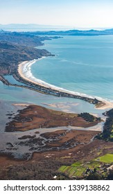 Aerial photo taken over Stinson Beach, CA during summer with Mt. Tam and San Francisco in horizon
