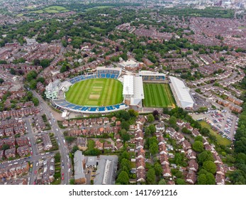 Aerial photo of  the. Emerald Headingley Stadium  and also of a typical town in the UK showing rows of houses, paths & roads, taken over Headingley in Leeds, which is in West Yorkshire in the UK.