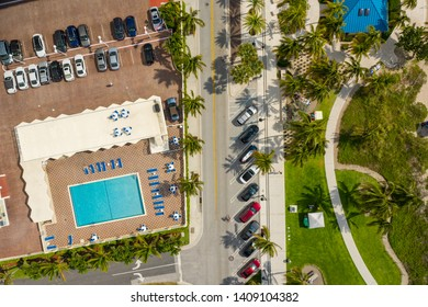 Aerial photo of a tourist destination palm trees and swimming pools