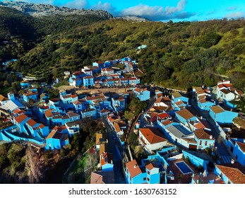 Aerial photo Júzcar town remarkable place all residential houses painted blue color, Valle del Genal, Serrania de Ronda, Málaga. Andalusia, southern Spain, first and only Smurfs Village in the World