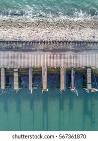 Aerial photo of a traditional boat jetty seen from above at low tide in Zeeland, The Netherlands
