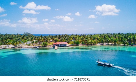 Aerial photo of tropical island South Water Caye  in Belize with boat docking