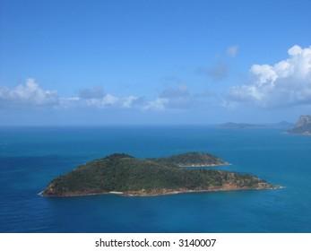 Aerial photo of a tropical island (Whitsunday islands, Queensland, Australia)