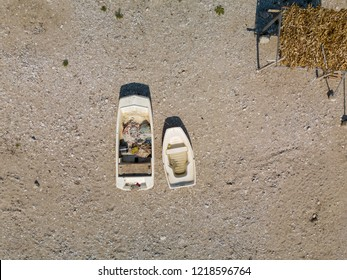 Aerial photo of two boats on beach in Albania (Albanian Riviera)