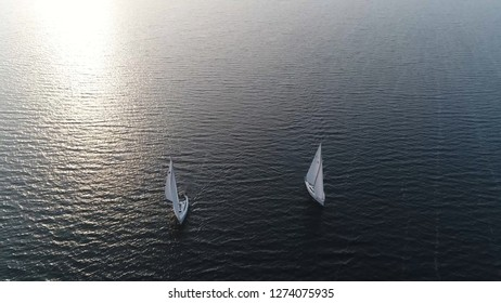 Aerial photo of two sloop vessels are sailing boats with single mast one head sail and fore plus aft rig the most common configuration of modern sailboats is the Bermuda-rigged one