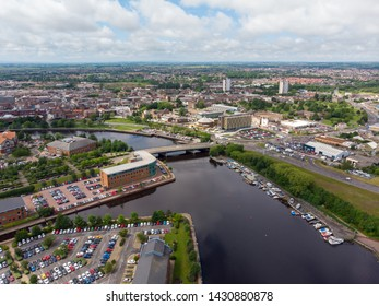 Aerial photo of the UK town of Middlesbrough a large post-industrial town on the south bank of the River Tees in the county of North Yorkshire, taken on a bright sunny day with boats on the river.