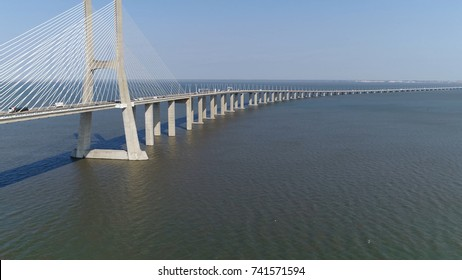 Aerial photo of Vasco da Gama Bridge in Portuguese Ponte Vasco da Gama cable-stayed bridge flanked by viaducts and rangeviews that spans Tagus River in Lisbon the capital of Portugal