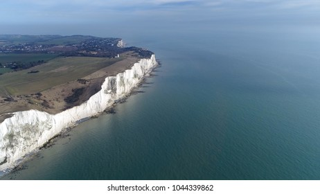 Aerial photo of The White Cliffs of Dover are cliffs that form part of English coastline facing the Strait of Dover they are part of the North Downs formation and cliff face has striking appearance