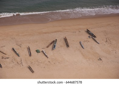 Aerial photograph of canoes, dugouts and nets, midday, on a ferry flight from Monrovia to Freetown.