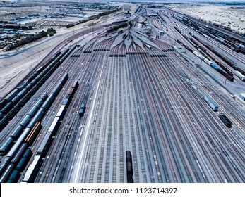 An aerial photograph of a garage where a California freight train is stopped.