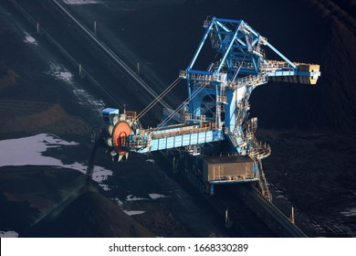 An aerial photograph of a huge coal transporter and bucket scoop at the coal storage area of Immingham docks in Lincolnshire. This image was taken from a helicopter on a winters day in 2016.