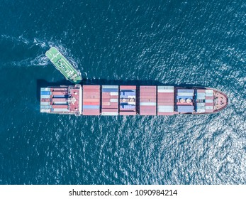 An aerial photograph of a large ship towing a small ship. - Shutterstock ID 1090984214