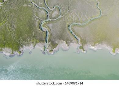 Aerial photograph of marsh and the Atlantic Ocean in Port Royal, South Carolina.