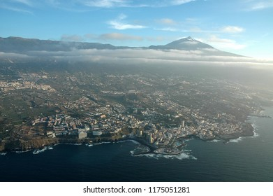 Aerial photograph of Puerto de la Cruz with Teide in the background on the north coast of Tenerife, Canary Islands, at sunset