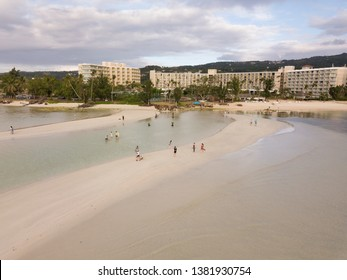 An aerial photograph of tourists on a sand bar in front of the Hyatt Regency hotel on Saipan. Photograph taken on April 15, 2019 on the island of Saipan, USA.