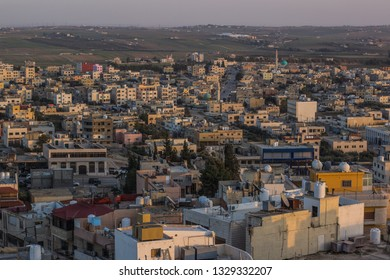 aerial photography of Arabic poor third world city in Middle East part of Earth in evening sunset time with soft colors and small stone buildings