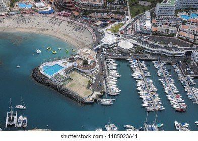 Aerial photography of the beach and marina of Colon on the coast of Adeje, Tenerife, Canary Islands