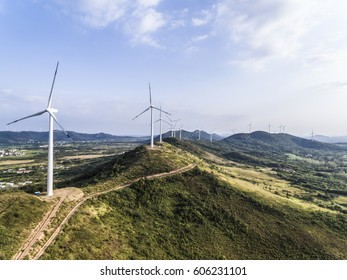 Aerial photography bird-eye view of Eco-environmentally friendly power generation of power turbines of green energy on the top of the hill