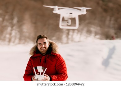 Aerial photography and drone footage details with man operating drone, flying drone