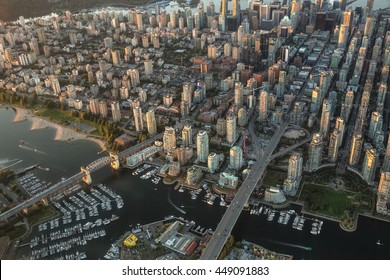 Aerial Photography of False Creek in Downtown Vancouver, British Columbia (BC), Canada, on a Hazy sunny sunset.