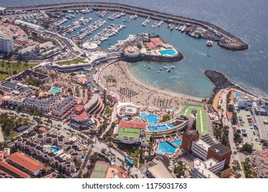 Aerial photography of the marina and beach of Colon in the Playa de las Americas, in the south of Tenerife, Canary Islands