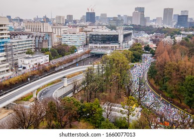 Aerial photography people running marathon on the road, shinjuku city half marathon, tokyo, japan.  January 24, 2020