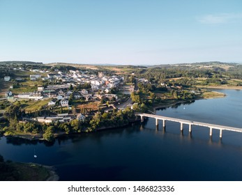 Aerial photography of Portomarin and its bridge, one of the stops along the French way of the Santiago Walk or St. James Way to Santiago de Compostela.