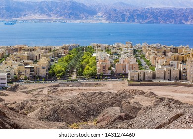 aerial photography of rest city on Red sea bay coast line with small cottages and living apartments buildings street district