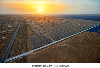 Aerial photography  Solar photovoltaic panels and highways at sunset