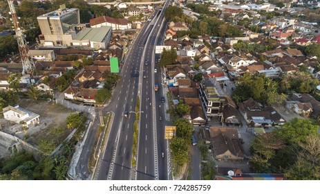 Aerial Photography of toll road and cityscape