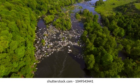 Aerial photography, top view, rapids on the river.A river flowing between stones in the forest.