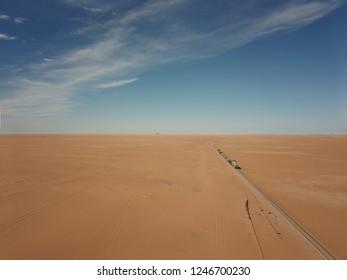 aerial photography of world longest train Sahara express in desert