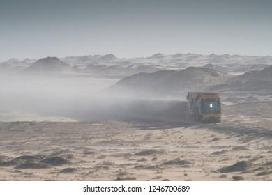 aerial photography of world longest train Sahara express in desert sandstorm