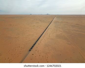 aerial photography of world longest train Sahara express in desert