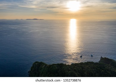 Aerial photograpy of sunset over tropical island of Koh Bon with Similan islands in the horizont