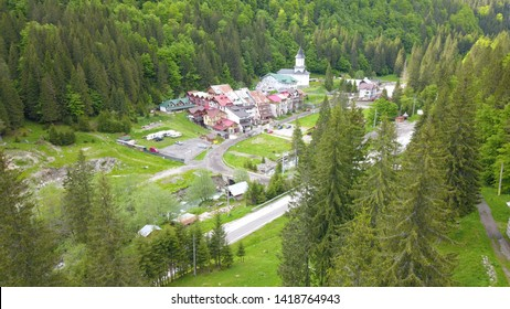 Aerial photos with a small village located in a mountain area on the Transfagarasan road.