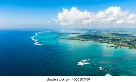 Aerial picture of the east coast of Mauritius Island. Beautiful lagoon of Mauritius Island shot from above.