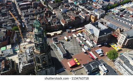 Aerial picture Grote Markt and Martinitoren highest church steeple in city of Groningen Netherlands and bell tower of Martinikerk located at north-eastern corner of Grote Markt Main Market Square