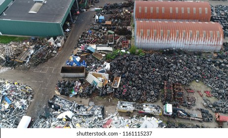 Aerial picture of junkyard a business in dismantling where wrecked or decommissioned vehicles are brought and the usable parts are sold for use in operating cars or to metal-recycling companies